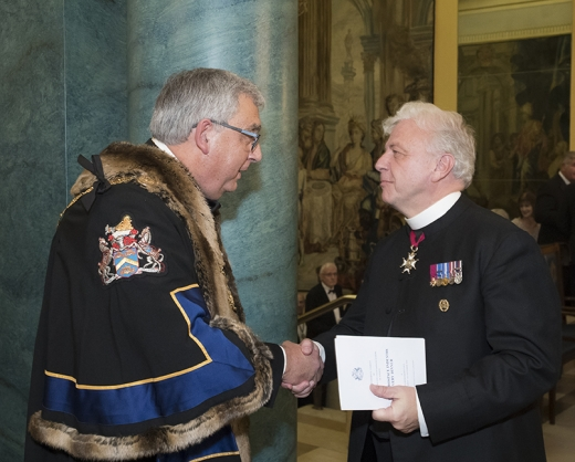 The Master greets the Honorary Chaplain, The Venerable Ray Pentland CB