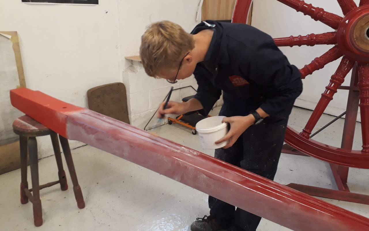 Tom painting undercoat on a wheel from the Lord Mayor's State Coach