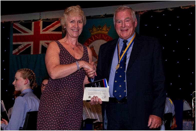 IPM Tony Edwards presents a cheque for £80,000 to Air Commodore Dawn McCafferty