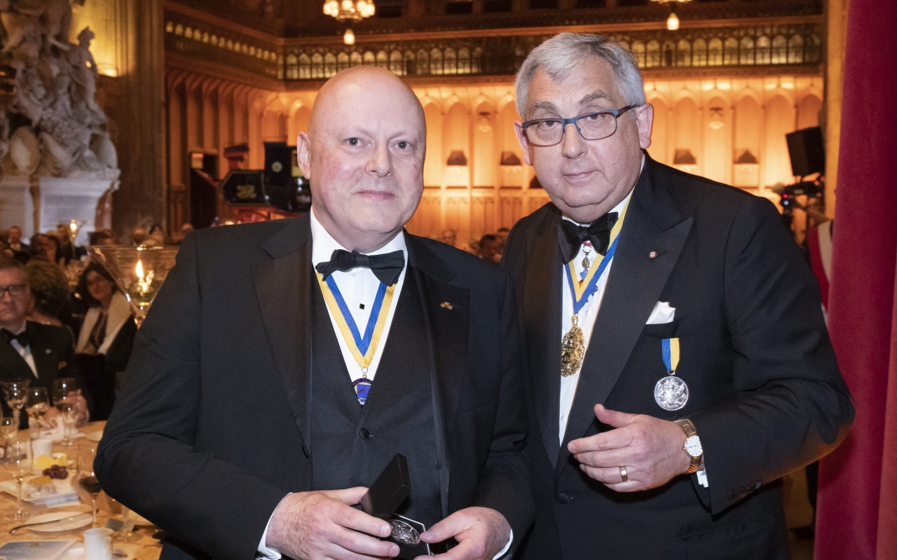 Hon Assistant John Blauth receives the Master's Silver Medal