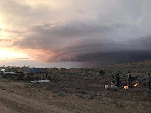 Making camp in the Karakum Desert with a storm approaching
