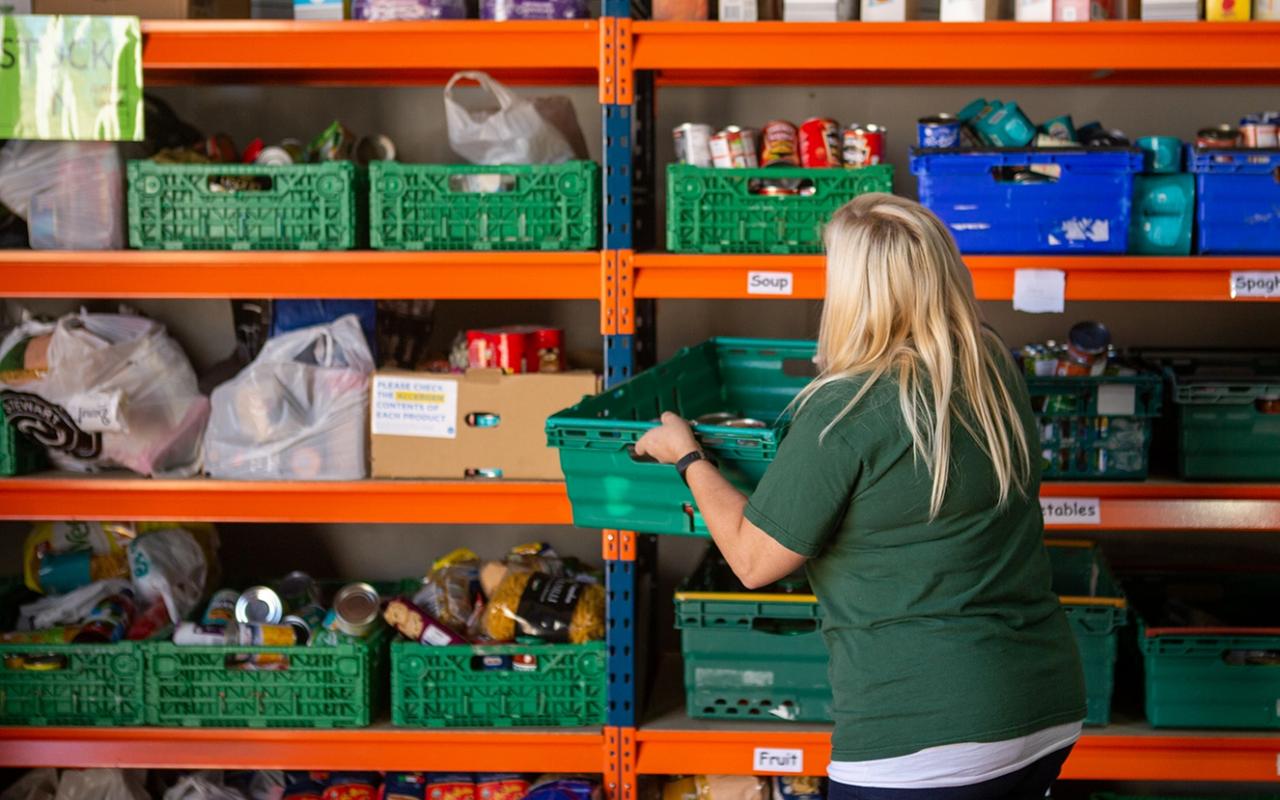 volunteer-stacking-shelves-in-foodbank-
